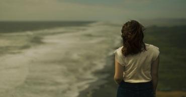 46033-woman-beach-walking-sad-dark1200u.1200w.tn